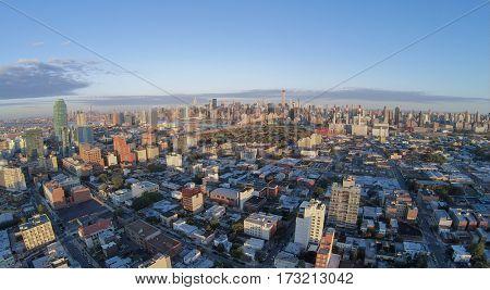 Cityscape with Dutch Kills quarter, Queensboro Bridge and Manhattan skyscrapers at summer evening. Aerial view