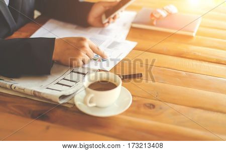 Business Man manager discussion ideas and writing business plan at workplace,man holding pens and papers for business data,notes documents,analysis chart at the table,vintage color,selective focus.