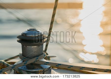 Winch and rope on sailing boat in the sea.