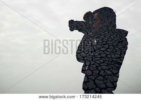 double exposure portrait of photographer against city skyline.