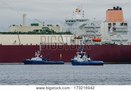 GAS CARRIER - Tugs support an LNG carrier for docking terminal in Swinoujscie
