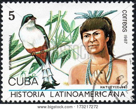 UKRAINE - CIRCA 2017: A stamp printed in Cuba shows Image of a chieftain Hatuey Cuba and bird Cuban Trogon Priotelus temnurus the series Latin American history circa 1987