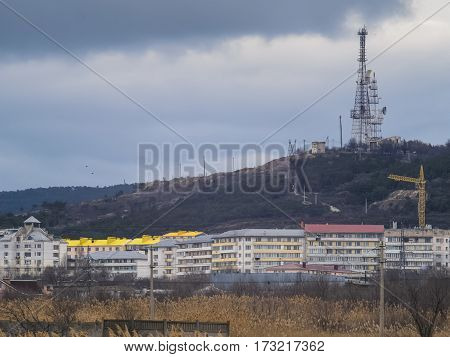 The suburbs and mountain with TV tower