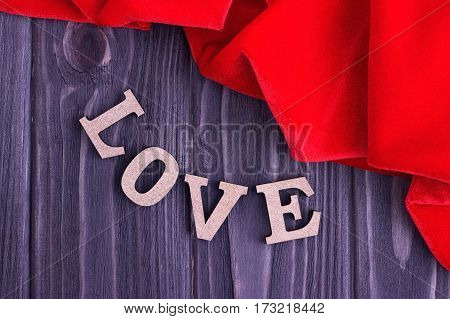 Valentine's Day Elegant Background With Love Lettering And Red Fabric On Wooden Background.