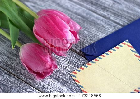 Beautiful Pink Tulips On Wooden Gray Background With Envelop.copy Space. Valentines Day.