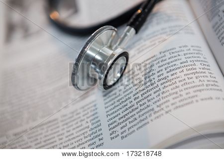 Close-up of stethoscope on open book