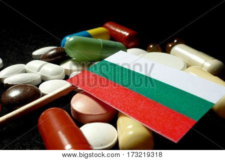 Bulgarian Flag With Lot Of Medical Pills Isolated On Black Background
