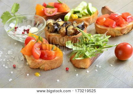 Various crostini with vegetables and herbs, selective focus