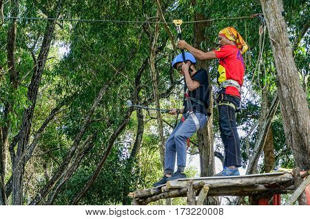 Labuan,Malaysia-Feb 12,2017:Happy people enjoying play on a flying fox in Labuan,Malaysia.There will be more ziplines in Malaysia,especially when there have so much natural resources & rainforest.