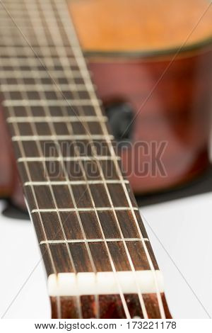 Acoustic Guitar Neck With Frets With Blurred Background
