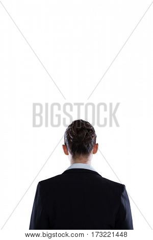 Rear view of businesswoman standing against white background