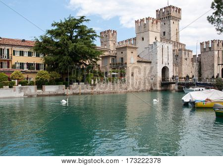 SIRMIONE ITALY - MAY 5 2016: Medieval castle Scaliger in old town Sirmione on lake Lago di Garda. Italy