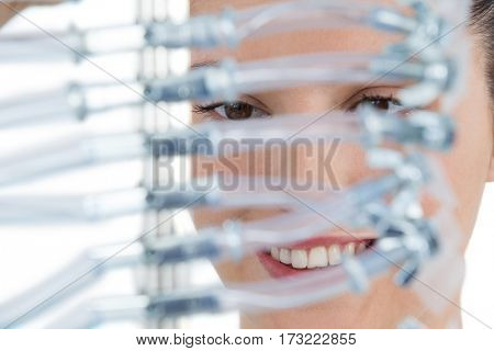 Female computer engineer holding computer cable against white background