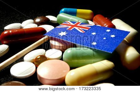 Australian Flag With Lot Of Medical Pills Isolated On Black Background