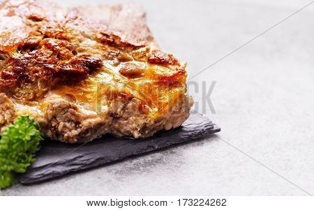 fried pork ribs with parsley on slate tablet