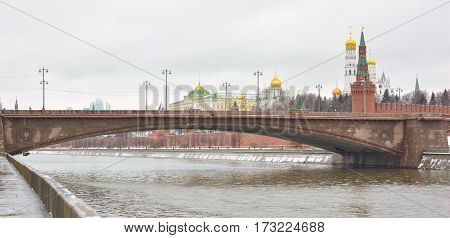 MOSCOW - February 24, 2017 View from the Sofia embankment on the Big Moskvoretsky bridge and Moscow Kremlin .Beautiful landscape against the backdrop of a cloudy sky.