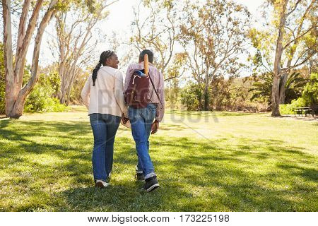 Mature Couple Going On Picnic In Park Together