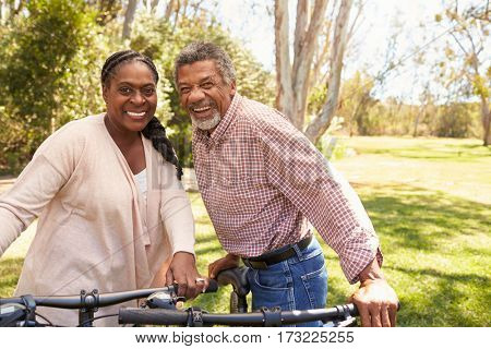 Portrait Of Mature Couple Going For Cycle Ride In Park