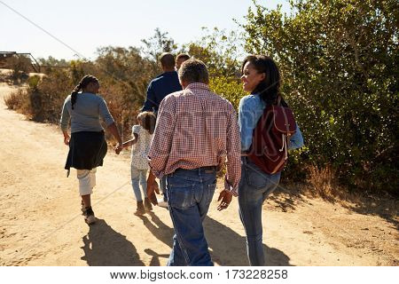 Multi Generation Family Walking In Countryside Together
