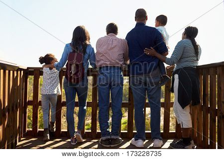 Multi Generation Family Standing On Outdoor Observation Deck