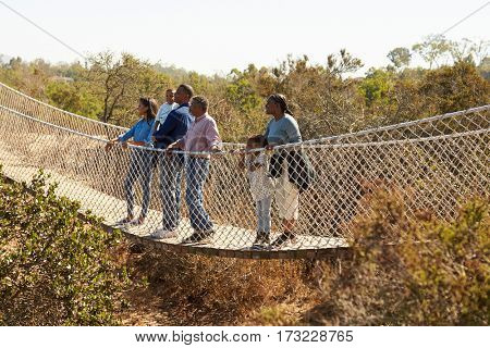 Multi Generation Family Crossing Rope Bridge Together