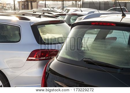 Parked Cars on a Lot. Row of New Cars on the Car Dealer Parking Lot. Cars for Sale Market Theme.