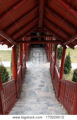Stone Stairs In Backyard Covered With A Wooden Roof