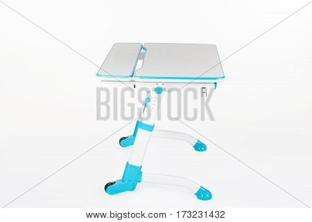 Blue school desk is isolated on a white background