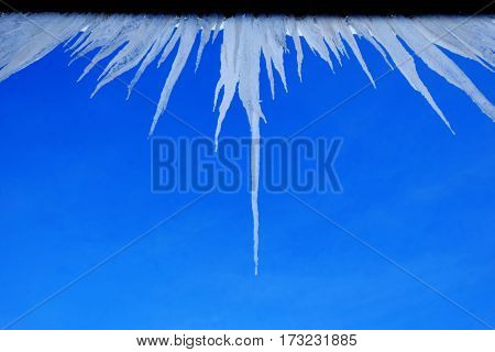 Icicles hanging from rooftop of home melted ice dripping