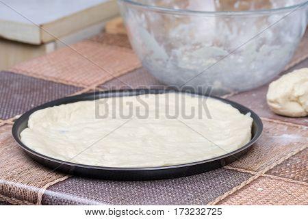 Raw Pizza Dough On Round Pan