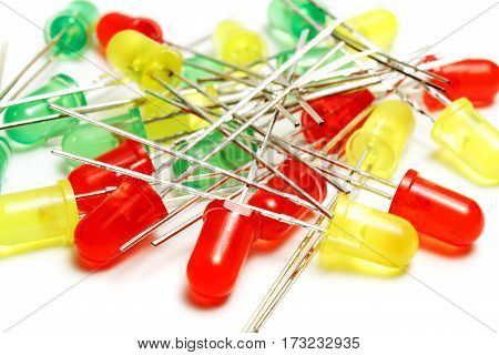 Closeup set of green yellow and red LED diodes on a white background