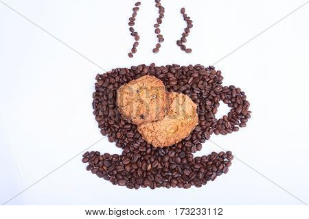 Coffee beans in the form of cup of coffee with cookie on the white background.