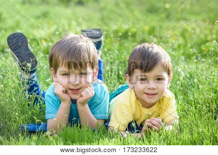 Happy Kid Enjoying Sunny Late Summer And Autumn Day In Nature On Green Grass.