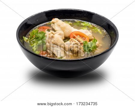 Hot and spicy chicken soup in black bowl on white background Thai food Tom Yum Chicken Tom Yum is thai delicious food.