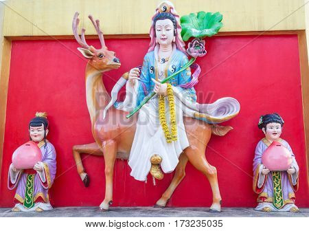 Statue of Guan Yin riding  with Graduates the companion.