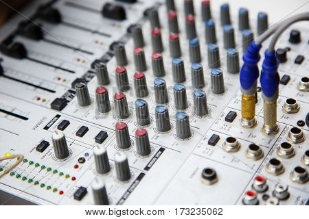 DJ sound mixer panel with knob, soft focus