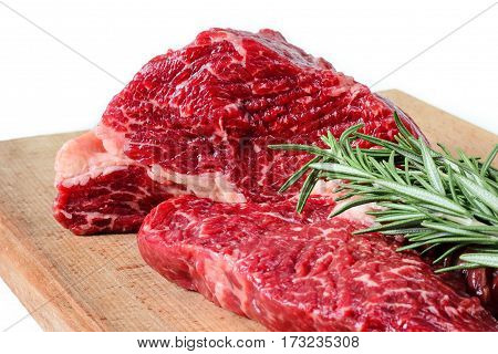 juicy piece of beef with rosemary on a white background