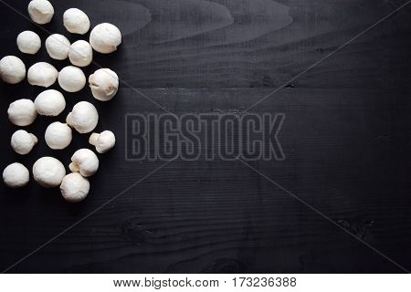 Mushrooms and sliced mushroom on a wooden surface, Fresh cultivated mushrooms