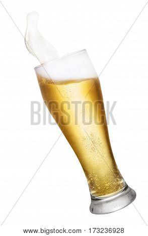 glass of splashing beer isolated on white background with clipping path. Glass with beer up. Golden beer splash. Falling glass of beer