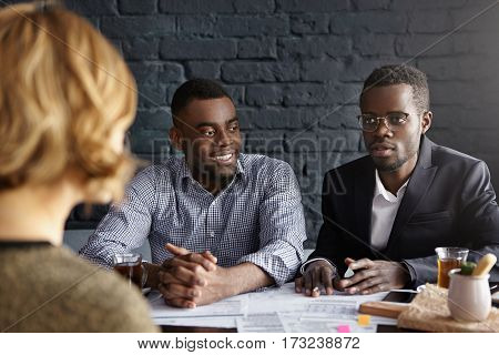People, Business And Communication Concept. Indoor Shot Of Serious Hr Manager In Glasses And His Smi