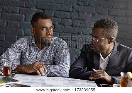 Two African Partners Having Lively Conversation While Discussing Company's Growth, Plans, Sharing Id