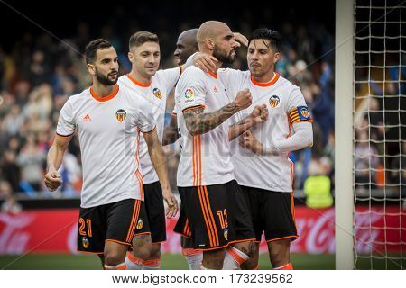 VALENCIA, SPAIN - FEBRUARY 19: Valencia players celebrate a goal during La Liga soccer match between Valencia CF and CD Athletic Club Bilbao at Mestalla Stadium on February 19, 2017 in Valencia, Spain