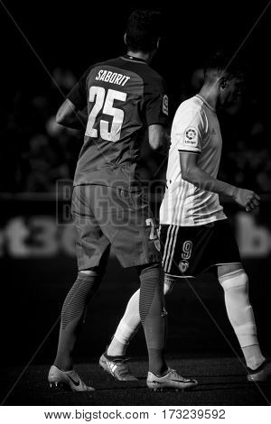 VALENCIA, SPAIN - FEBRUARY 19: 25 Saborit and Munir during La Liga soccer match between Valencia CF and CD Athletic Club Bilbao at Mestalla Stadium on February 19, 2017 in Valencia, Spain