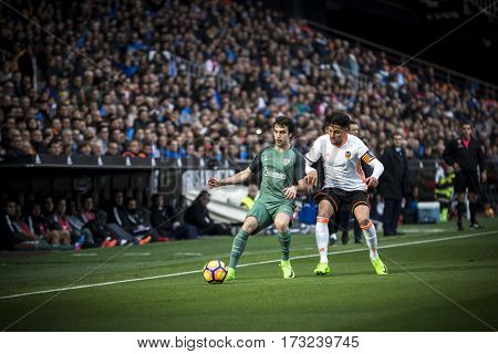 VALENCIA, SPAIN - FEBRUARY 19: (L) Lekue, (R) Perez during La Liga soccer match between Valencia CF and CD Athletic Club Bilbao at Mestalla Stadium on February 19, 2017 in Valencia, Spain