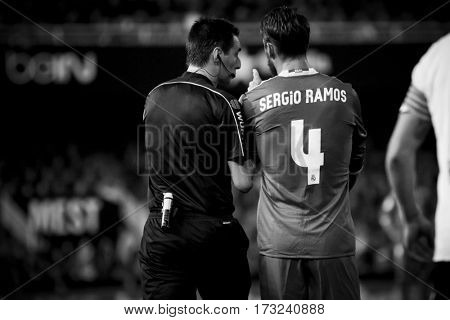 VALENCIA, SPAIN - FEBRUARY 22: 4 Ramos talks with referee during La Liga soccer match between Valencia CF and Real Madrid at Mestalla Stadium on February 22, 2017 in Valencia, Spain