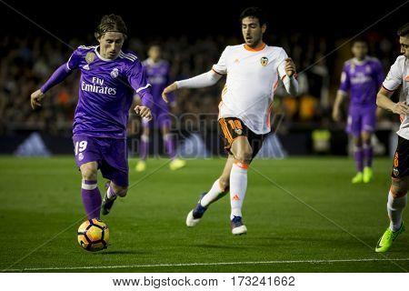 VALENCIA, SPAIN - FEBRUARY 22: (L) Luka Modric during La Liga soccer match between Valencia CF and Real Madrid at Mestalla Stadium on February 22, 2017 in Valencia, Spain