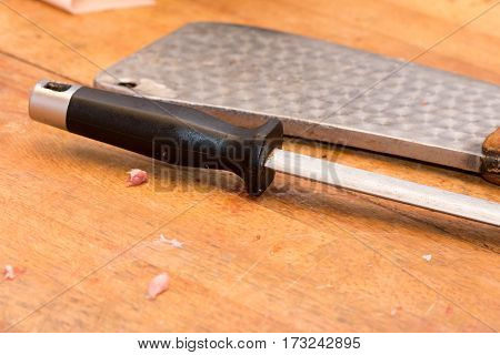 Butchers Knife And Cleaver On The Table