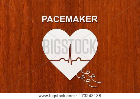Heart shape with echocardiogram and PACEMAKER text. Medical cardiology concept