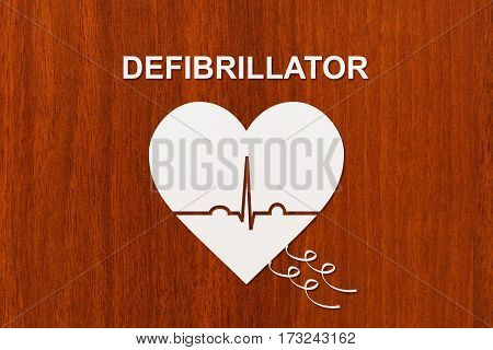 Heart shape with echocardiogram and DEFIBRILLATOR text. Medical cardiology concept