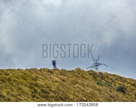 Man Taking Photo At Highs Of Andes Range